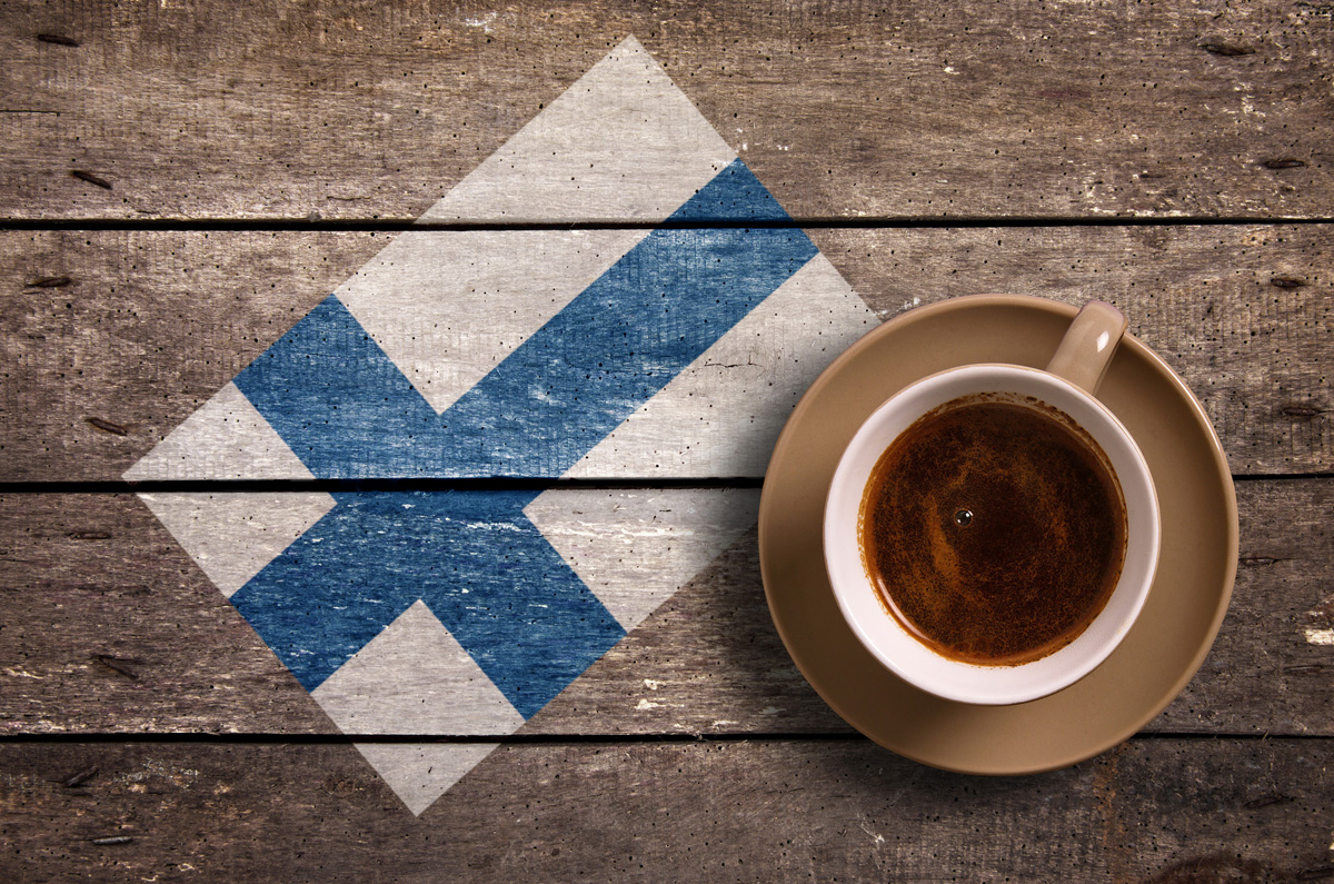 Finland flag with coffee on table. top view