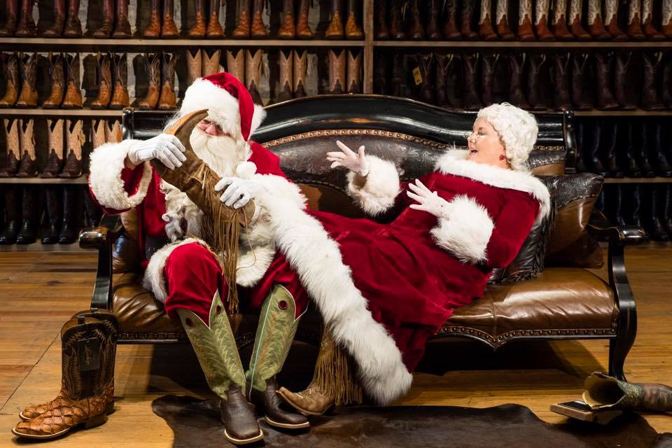 Cowboy Santa & Mrs. Claus trying on boots at Harry's Boots
