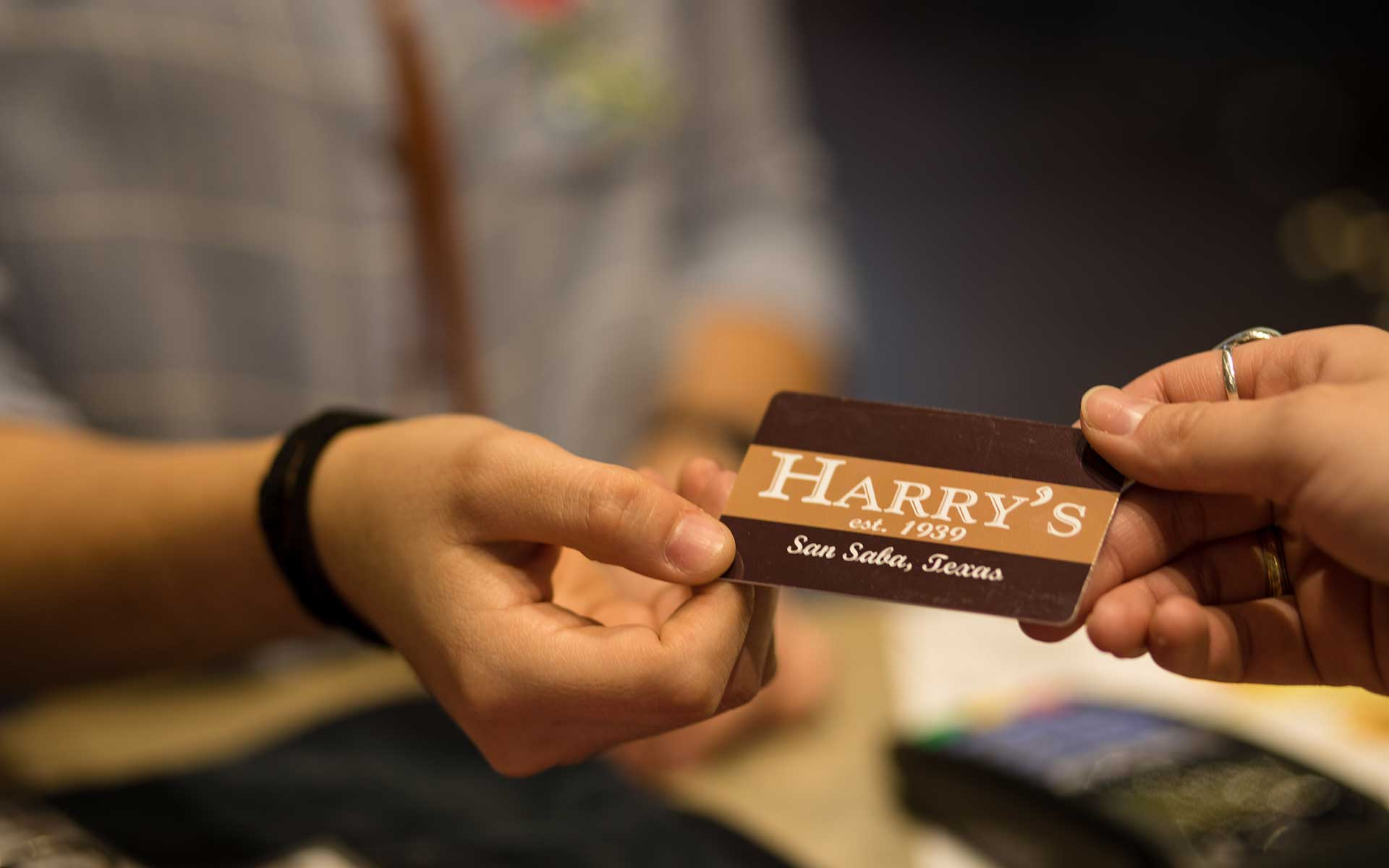 People holding Harry's business card